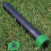 Mole repeller on the grass. Photo also shows mole repeller in the ground.